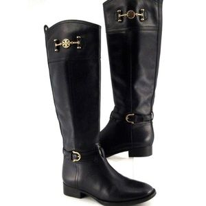 Tory Burch black leather boots with gold detail.